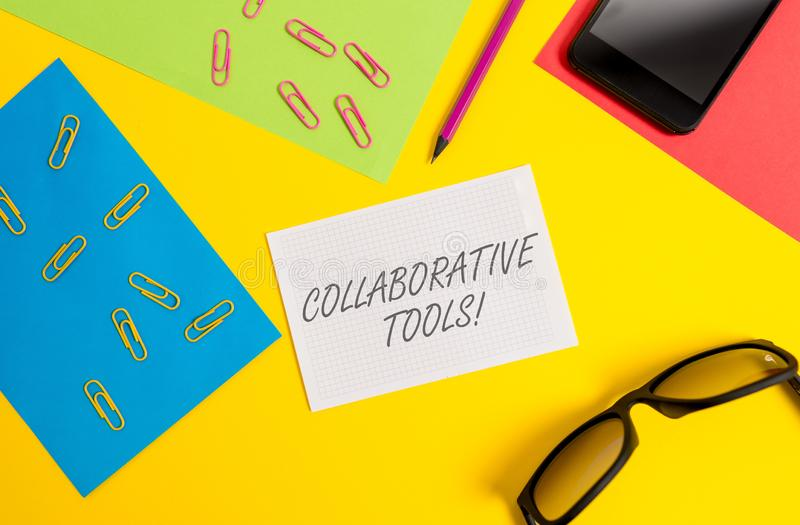 Text sign showing Collaborative Tools. Conceptual photo Private Social Network to Connect thru Online Email Paper sheets royalty free stock photo