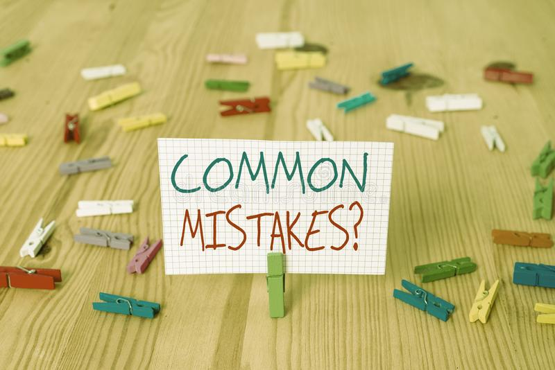 Text sign showing Common Mistakes question. Conceptual photo repeat act or judgement misguided or wrong Colored. Text sign showing Common Mistakes question stock photography