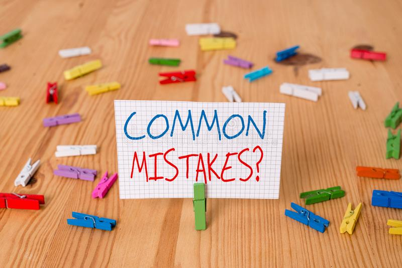 Text sign showing Common Mistakes question. Conceptual photo repeat act or judgement misguided or wrong Colored. Text sign showing Common Mistakes question stock image