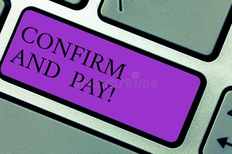 Text sign showing Confirm And Pay. Conceptual photo Check out your purchases and make a payment Confirmation Keyboard key. Intention to create computer message royalty free stock images