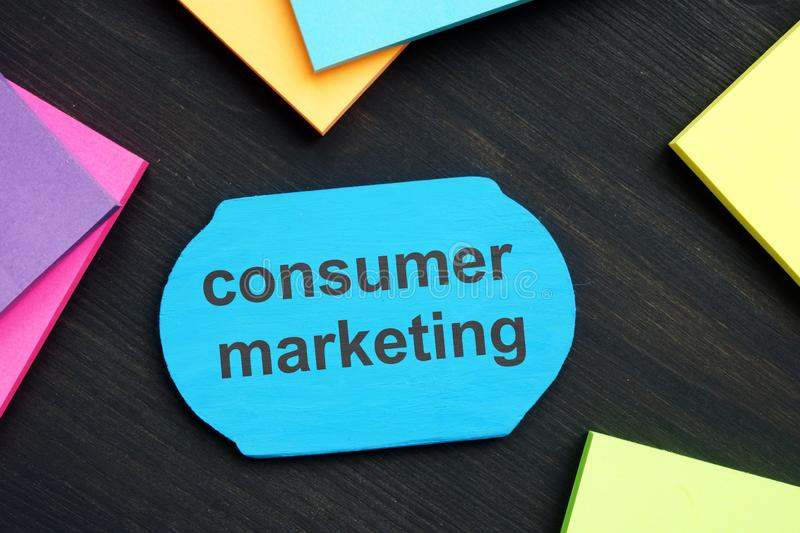 Text sign showing consumer marketing. The text is written on a small wooden board stock photography