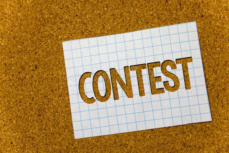 Text sign showing Contest. Conceptual photo Game Tournament Competition Event Trial Conquest Battle Struggle Cork background noteb. Ook paper ideas messages stock images