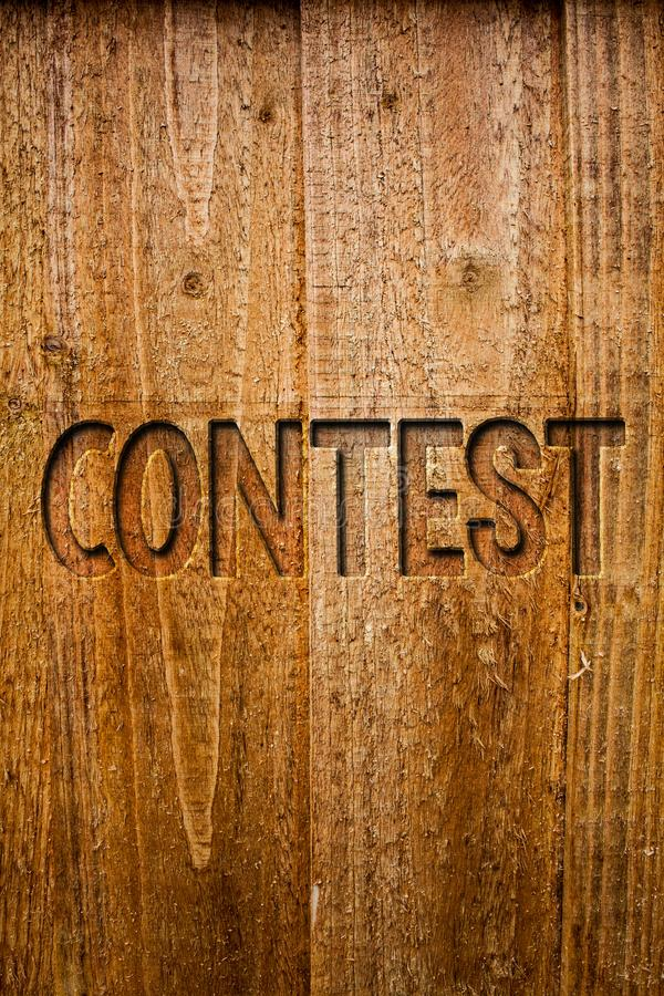 Text sign showing Contest. Conceptual photo Game Tournament Competition Event Trial Conquest Battle Struggle Ideas messages wooden. Background intentions royalty free stock images