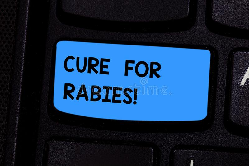 Text sign showing Cure For Rabies. Conceptual photo Vaccination medicines to fight against illness lethal virus Keyboard royalty free stock photos