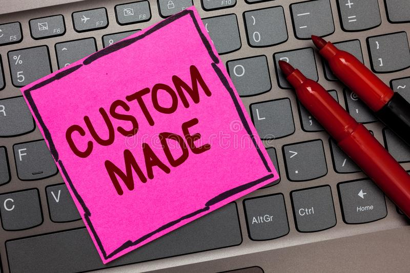Text sign showing Custom Made. Conceptual photo something is done to order for particular customer organization Pink paper keyboar stock photo