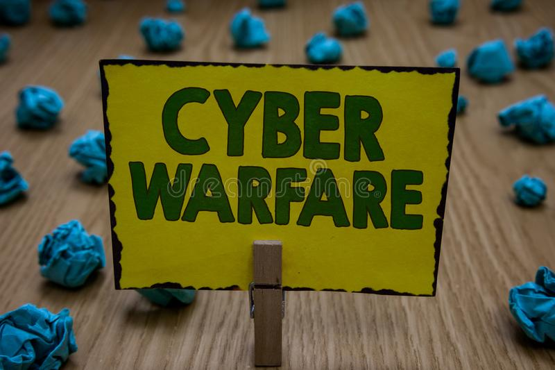 Text sign showing Cyber Warfare. Conceptual photo Virtual War Hackers System Attacks Digital Thief Stalker Clothespin holding yell stock photography