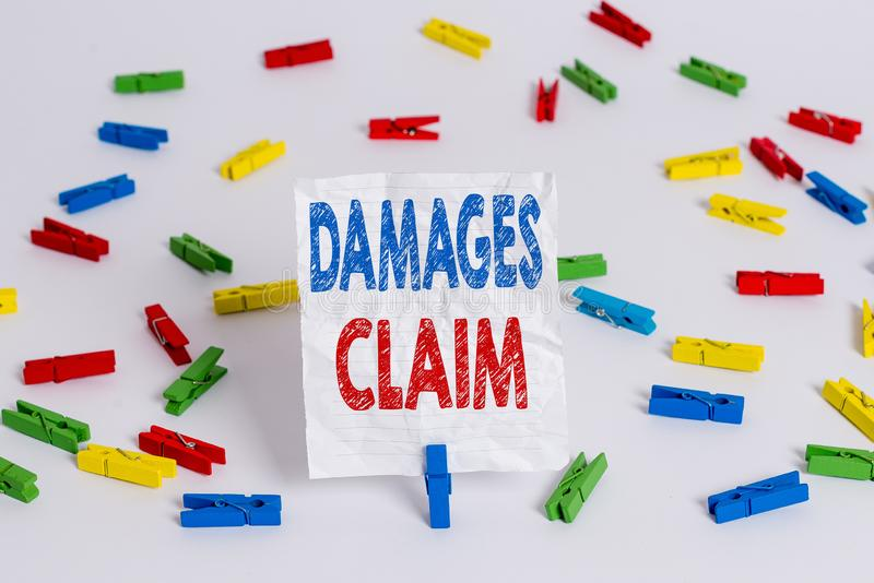 Text sign showing Damages Claim. Conceptual photo Deanalysisd Compensation Litigate Insurance File Suit Colored clothespin papers. Text sign showing Damages royalty free stock photography