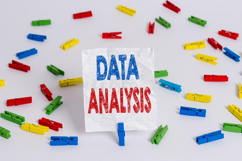Text sign showing Data Analysis. Conceptual photo Translate numbers to Analytical Conclusion Forecasting Colored clothespin papers. Text sign showing Data royalty free stock photo