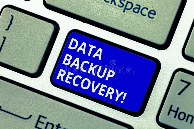 Text sign showing Data Backup Recovery. Conceptual photo the process of backing up data in case of a loss Keyboard key. Intention to create computer message royalty free stock photography