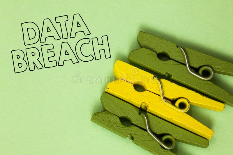 Text sign showing Data Breach. Conceptual photo security incident where sensitive protected information copied Three green yellow. Vintage clothespins clear royalty free stock photos