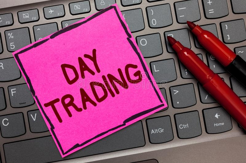 Text sign showing Day Trading. Conceptual photo securities specifically buying and selling financial instruments Pink paper keyboa stock images