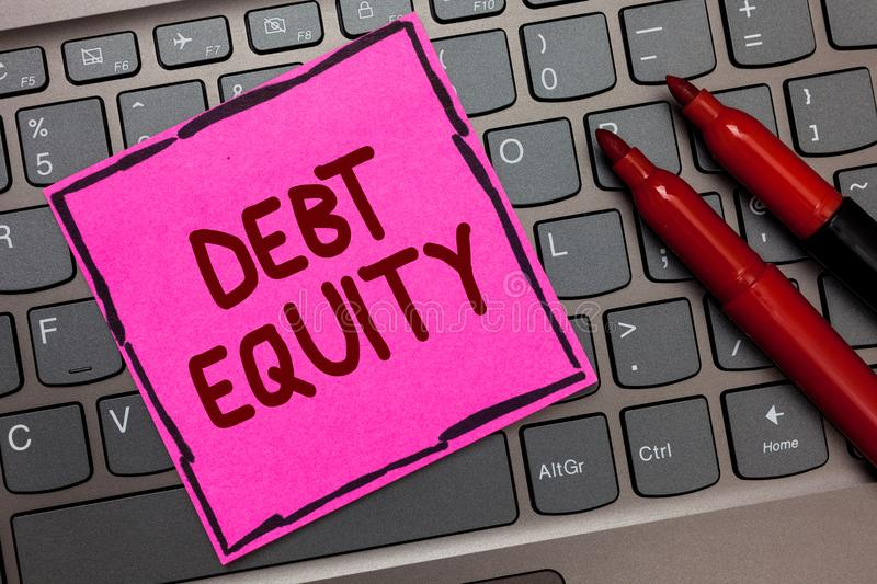 Text sign showing Debt Equity. Conceptual photo dividing companys total liabilities by its stockholders Pink paper keyboard Inspir. Ation communicate ideas royalty free stock image