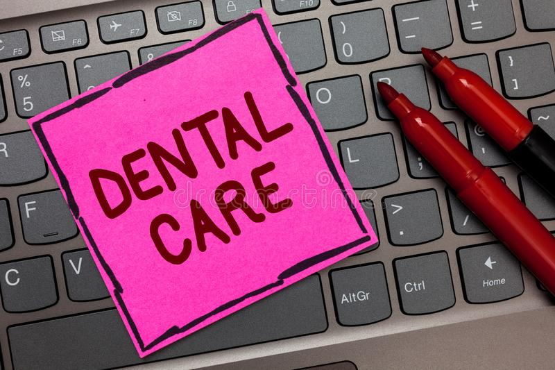 Text sign showing Dental Care. Conceptual photo maintenance of healthy teeth or to keep it clean for future Pink paper keyboard In. Spiration communicate ideas stock photo