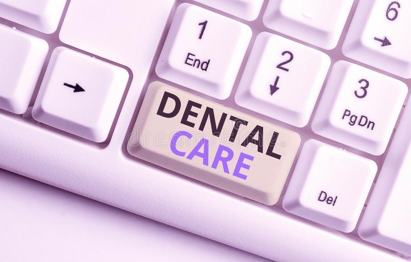 Text sign showing Dental Care. Conceptual photo maintenance of healthy teeth or to keep it clean for future White pc. Text sign showing Dental Care. Business royalty free stock photos
