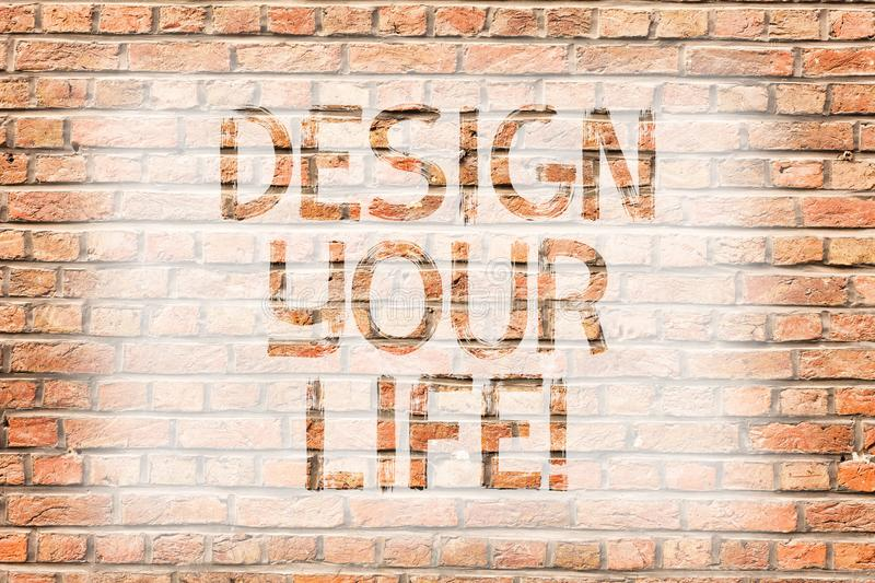 Text sign showing Design Your Life. Conceptual photo Set plans Life goals Dreams take control To do list Brick Wall art stock photography