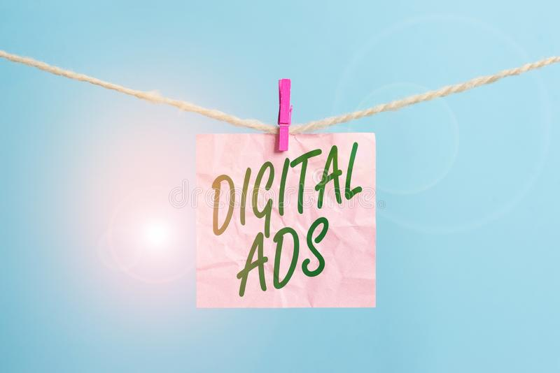 Text sign showing Digital Ads. Conceptual photo uses the Internet to deliver promotional marketing messages Clothesline. Text sign showing Digital Ads. Business stock photos