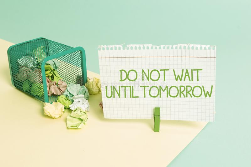 Text sign showing Do Not Wait Until Tomorrow. Conceptual photo needed to do it right away Urgent Better do now Trash bin. Text sign showing Do Not Wait Until stock images