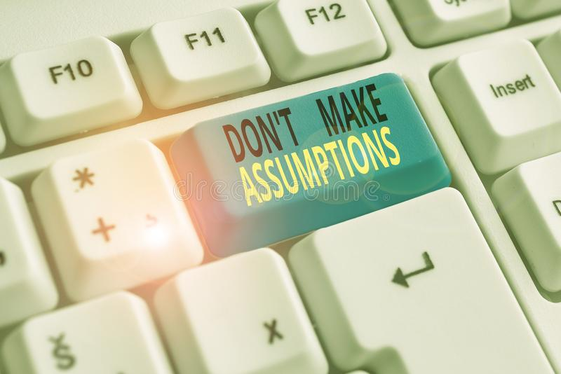 Text sign showing Don T Make Assumptions. Conceptual photo putting plan in future with percentage happening White pc. Text sign showing Don T Make Assumptions royalty free stock photo