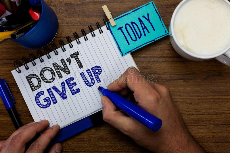 Text sign showing Don t not Give Up. Conceptual photo Determined Persevering Continue to Believe in Yourself Man holding marker no royalty free stock photos