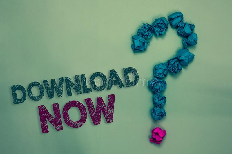 Text sign showing Download Now. Conceptual photo To copy or move programs or information into another device Crumpled papers formi. Ng question mark several royalty free stock images