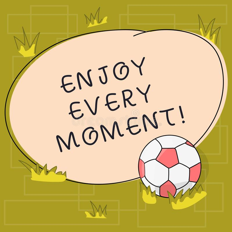 Text sign showing Enjoy Every Moment. Conceptual photo Remove unneeded possessions Minimalism force live present Soccer. Ball on the Grass and Blank Outlined stock illustration