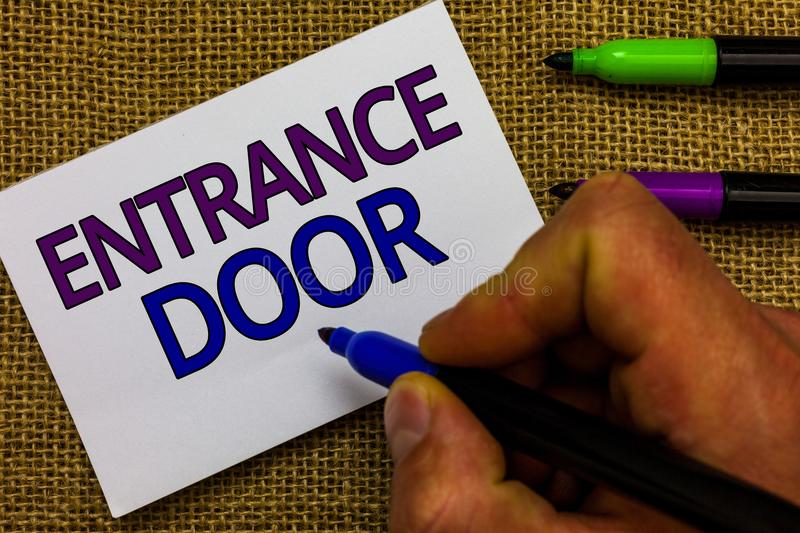 Text sign showing Entrance Door. Conceptual photo Way in Doorway Gate Entry Incoming Ingress Passage Portal Man hand holding marke stock photos