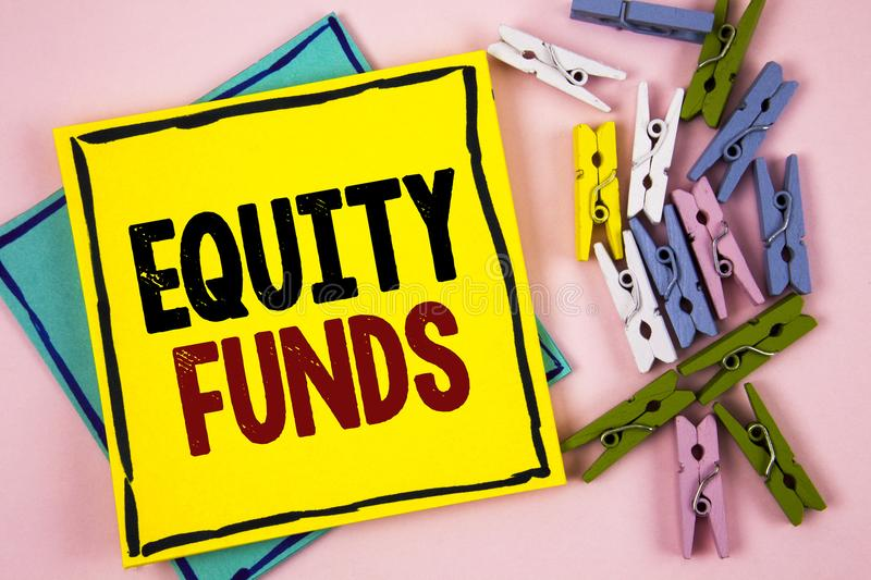 Text sign showing Equity Funds. Conceptual photo Investors enjoys great benefits with long term investment written on Sticky Note. Text sign showing Equity Funds stock photos