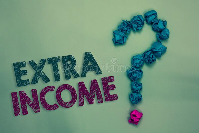 Text sign showing Extra Income. Conceptual photo Additional fund received or earned from a non regular basis Crumpled papers formi. Ng question mark several royalty free stock image