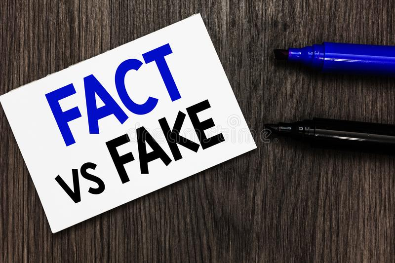 Text sign showing Fact Vs Fake. Conceptual photo Rivalry or products or information originaly made or imitation Important idea ide. As notebook marker markers royalty free stock photos