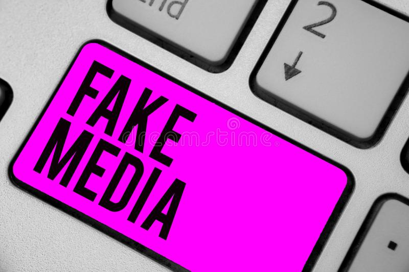 Text sign showing Fake Media. Conceptual photo An formation held by brodcasters which we cannot rely on Keyboard purple key Intent. Ion create computer computing stock image