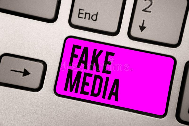 Text sign showing Fake Media. Conceptual photo An formation held by brodcasters which we cannot rely on Keyboard purple key Intent. Ion create computer computing royalty free stock photos