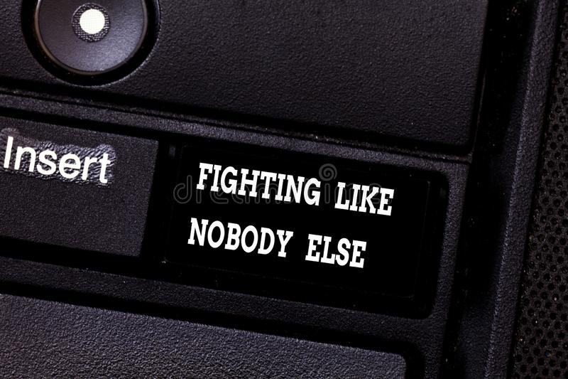 Text sign showing Fighting Like Nobody Else. Conceptual photo Fight for your rights motivated to win competition. Keyboard key Intention to create computer royalty free stock image