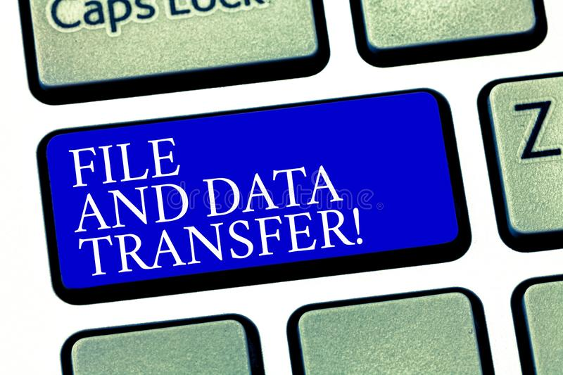 Text sign showing File And Data Transfer. Conceptual photo Transferring information online by the internet Keyboard key stock photography