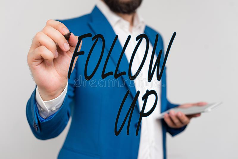 Text sign showing Follow Up. Conceptual photo a continuation of something that has already been started Businessman in. Text sign showing Follow Up. Business royalty free stock photography