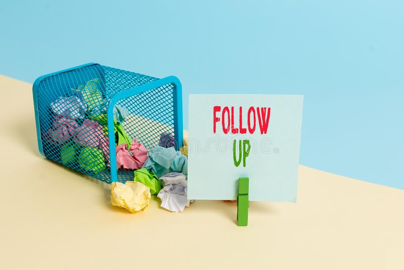 Text sign showing Follow Up. Conceptual photo a continuation of something that has already been started Trash bin. Text sign showing Follow Up. Business photo royalty free stock photos