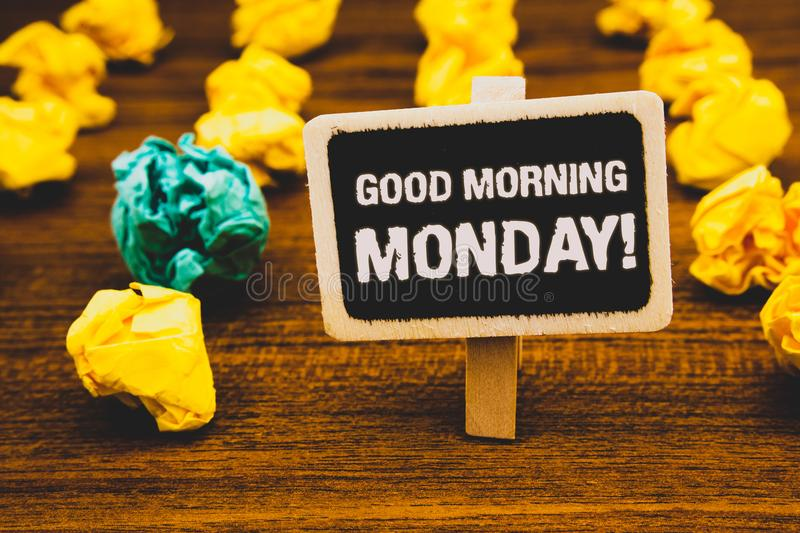 Text sign showing Good Morning Monday Motivational Call. Conceptual photo Happy Positivity Energetic Breakfast Blackboard with let. Ters wooden floor blurry stock image