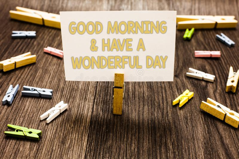 Text sign showing Good Morningand Have A Wonderful Day. Conceptual photo greeting someone in start of the day Clothespin holding w. Hite paper note several royalty free stock photos