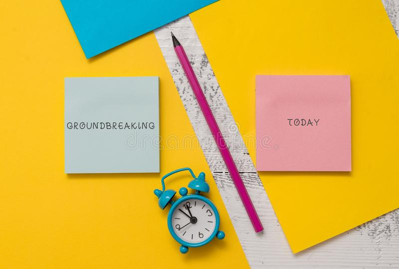 Text sign showing Groundbreaking. Conceptual photo Very new and a big change from other things of its type Notepads. Text sign showing Groundbreaking. Business stock image