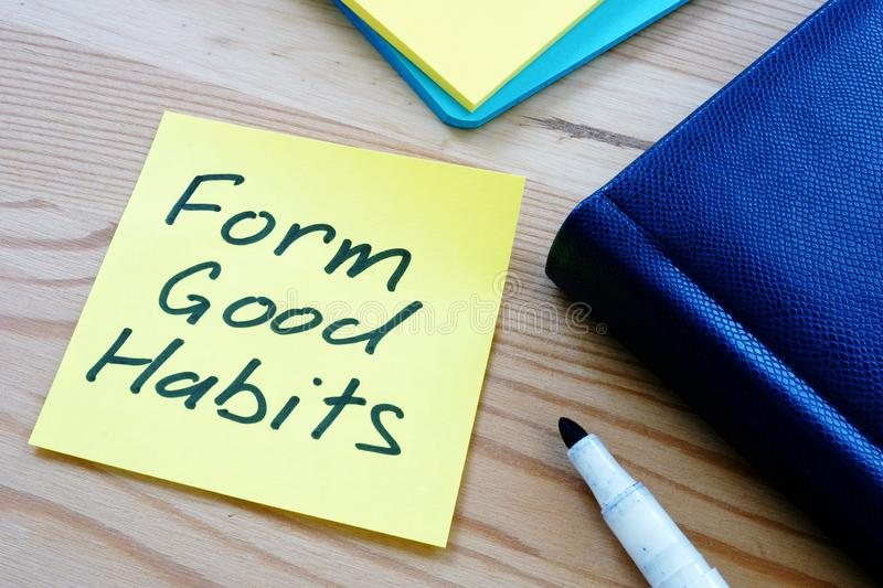 Text sign showing hand writing words Form good habits. Text sign shows hand writing words Form good habits royalty free stock photography