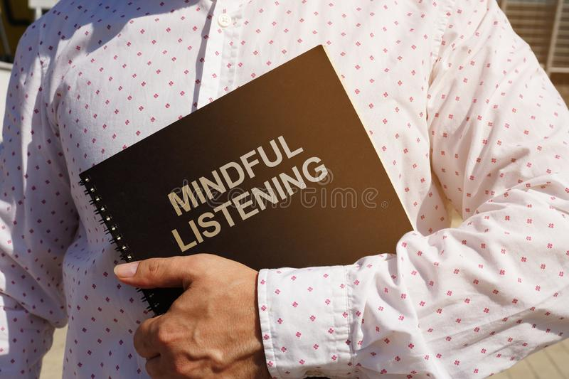 Text sign showing hand writing words Mindful Listening. Text sign shows hand writing words Mindful Listening stock photo