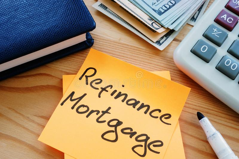 Text sign showing hand written words refinance mortgage. Text sign shows hand written words refinance mortgage royalty free stock photo