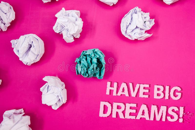Text sign showing Have Big Dreams Motivational Call. Conceptual photo Future Ambition Desire Motivation Goal Text Words pink backg. Round crumbled paper notes royalty free stock photo