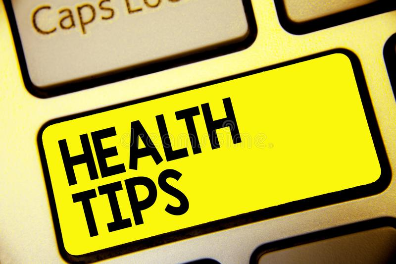 Text sign showing Health Tips. Conceptual photo state of complete physical mental and social well being Keyboard yellow key Intent. Ion create computer computing royalty free illustration