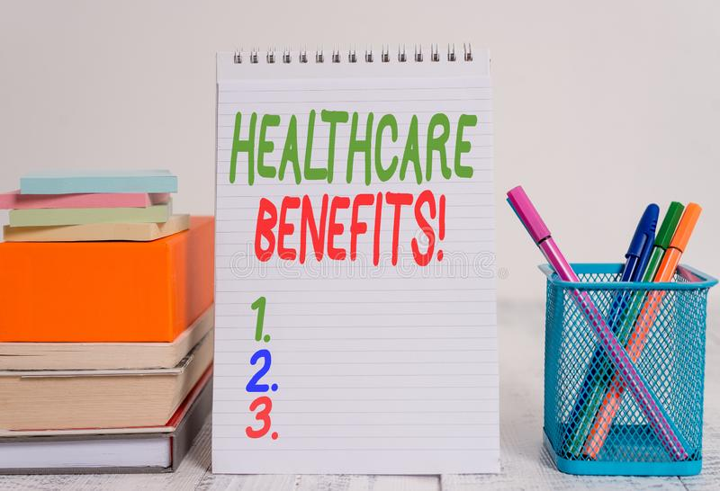 Text sign showing Healthcare Benefits. Conceptual photo monthly fair market valueprovided to Employee dependents Pens metal holder. Text sign showing Healthcare royalty free stock images