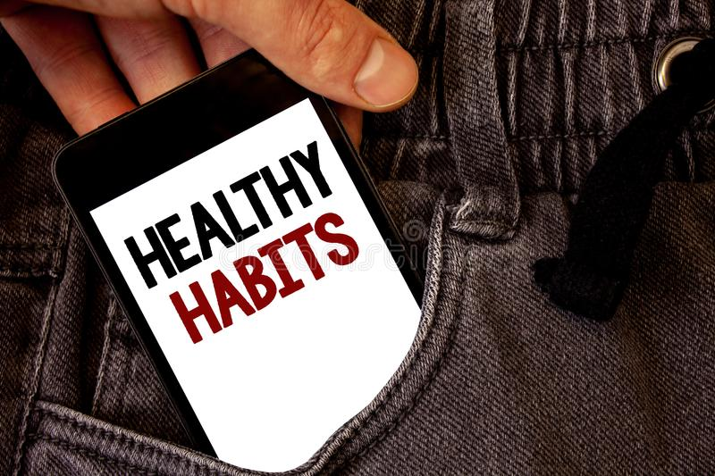 Text sign showing Healthy Habits. Conceptual photo Good nutrition diet take care of oneself Weight Control Text two words on white. Screen black Phone Hand royalty free illustration