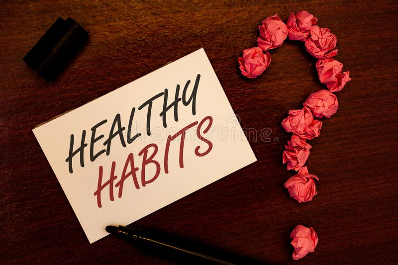 Text sign showing Healthy Habits. Conceptual photo Good nutrition diet take care of oneself Weight Control Text white paper note b. Lack marker open cap pink royalty free stock photography