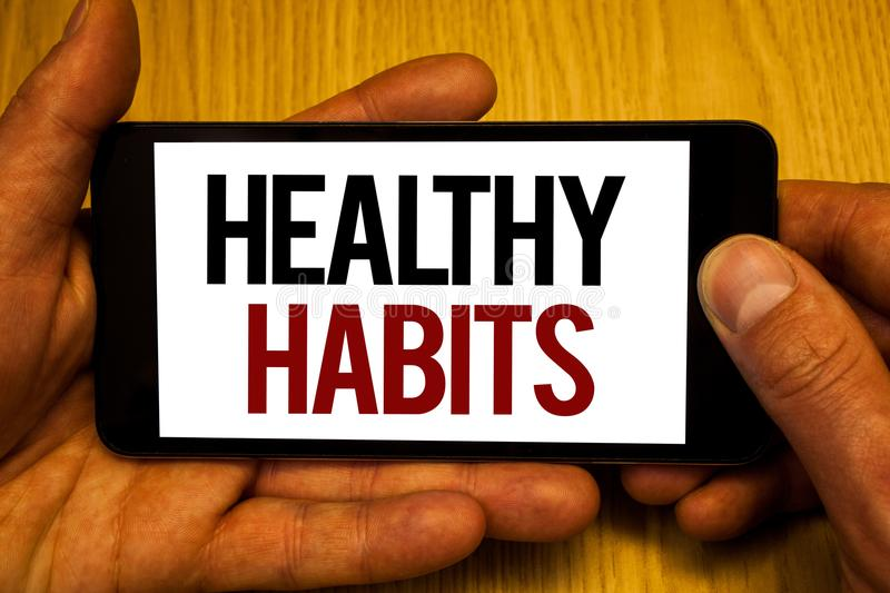 Text sign showing Healthy Habits. Conceptual photo Good nutrition diet take care of oneself Weight Control Two hands holding black. Phone screen words written vector illustration