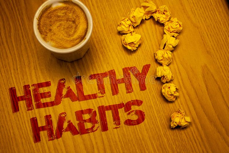 Text sign showing Healthy Habits. Conceptual photo Good nutrition diet take care of oneself Weight Control Words written Desk Coff. Ee White mug crumbled paper stock images