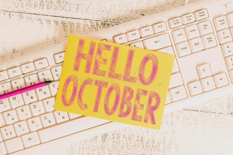 Text sign showing Hello October. Conceptual photo Last Quarter Tenth Month 30days Season Greeting White keyboard office. Text sign showing Hello October stock image