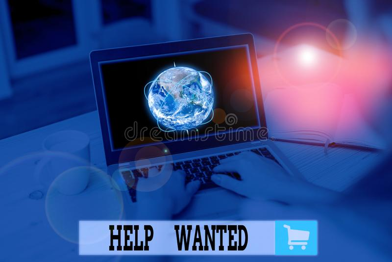 Text sign showing Help Wanted. Conceptual photo An ad in the paper an employer places to find a new employee Picture photo system. Text sign showing Help Wanted royalty free stock photos